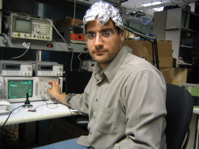 a scientist in a tinfoil hat