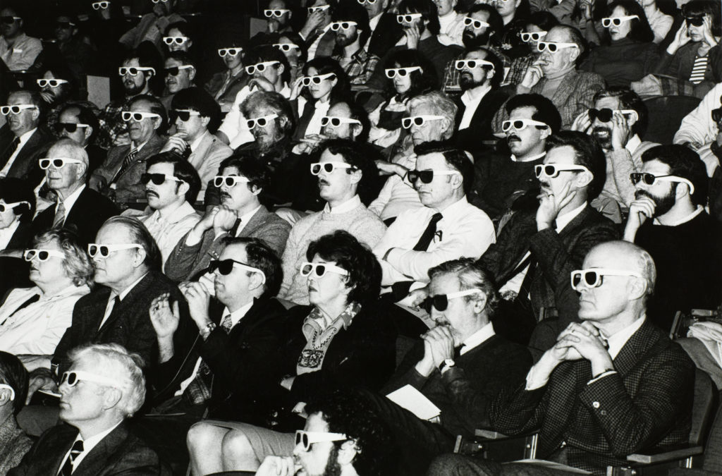 movie theater audience with 3d glasses